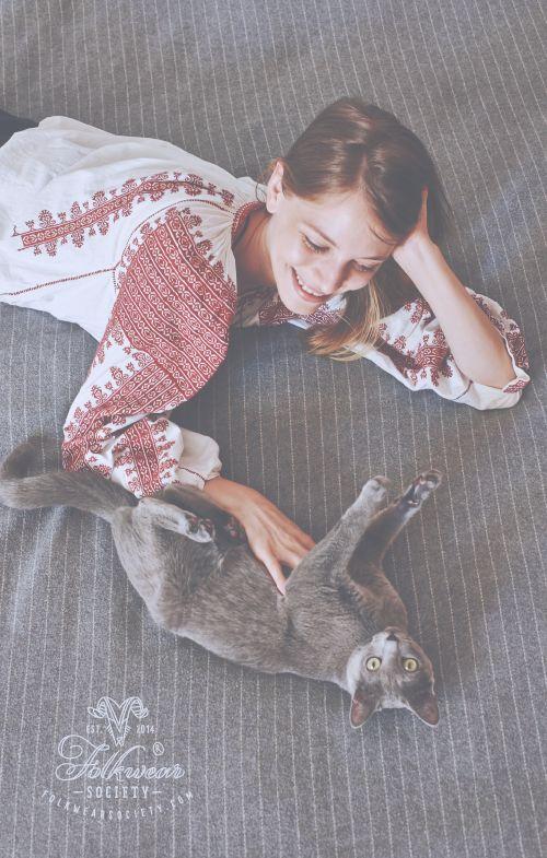 "www.folkwearsociety.com Adela is wearing a mesmerizing Romanian folk blouse (""ie"") from the ethnographic area of Muscel. Grizuki, the kitten, is wearing its heritage Blue Russian fur coat :-)"