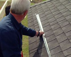 Installing a rain diverter on roof.