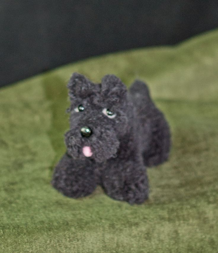 Pom pom animals. Scottie - sculpted wool. I made this little guy on a handmade loom. You wrap wool around the loom, sew on 18-gauge wire, and then shape the wool with scissors. Messy - I go through vacuum cleaner bags like crazy!