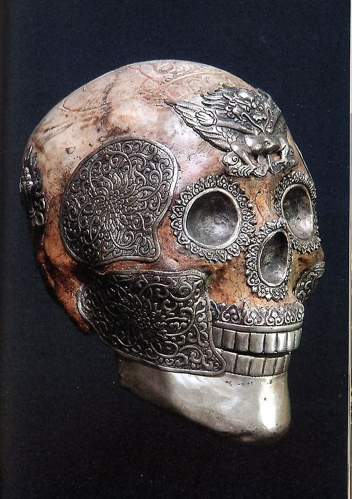 Tibetan ritual skull with silver work and garuda on the forehead.  A garuda is a large mythical bird or bird-like creature that appears in both Hindu and Buddhist mythology.