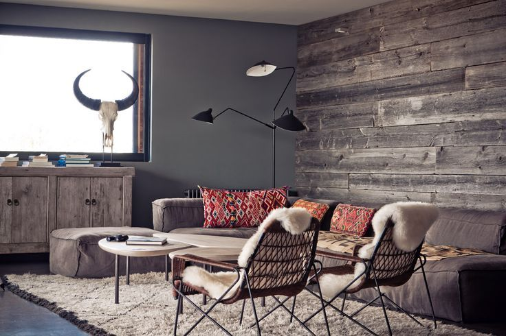 Amazing recycled wooden feature wall, teamed with the awesome concrete walls. The slate floor and the accents of boho, in the cushions, make this space masculine, but striking!