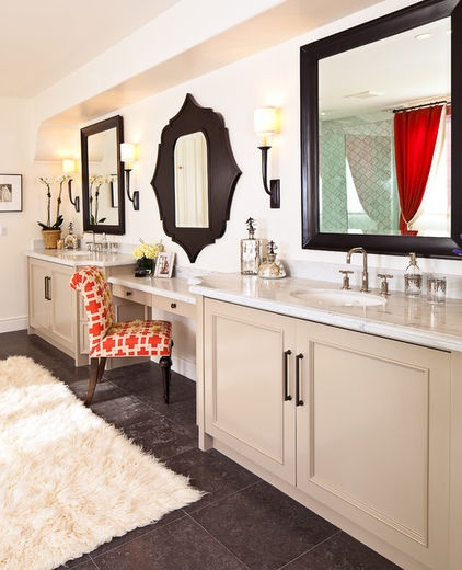 Bronze cabinet hardware and wall sconces match beautifully with this bathroom's masculine mirrors, while nickel plumbing fixtures add a feminine touch.
