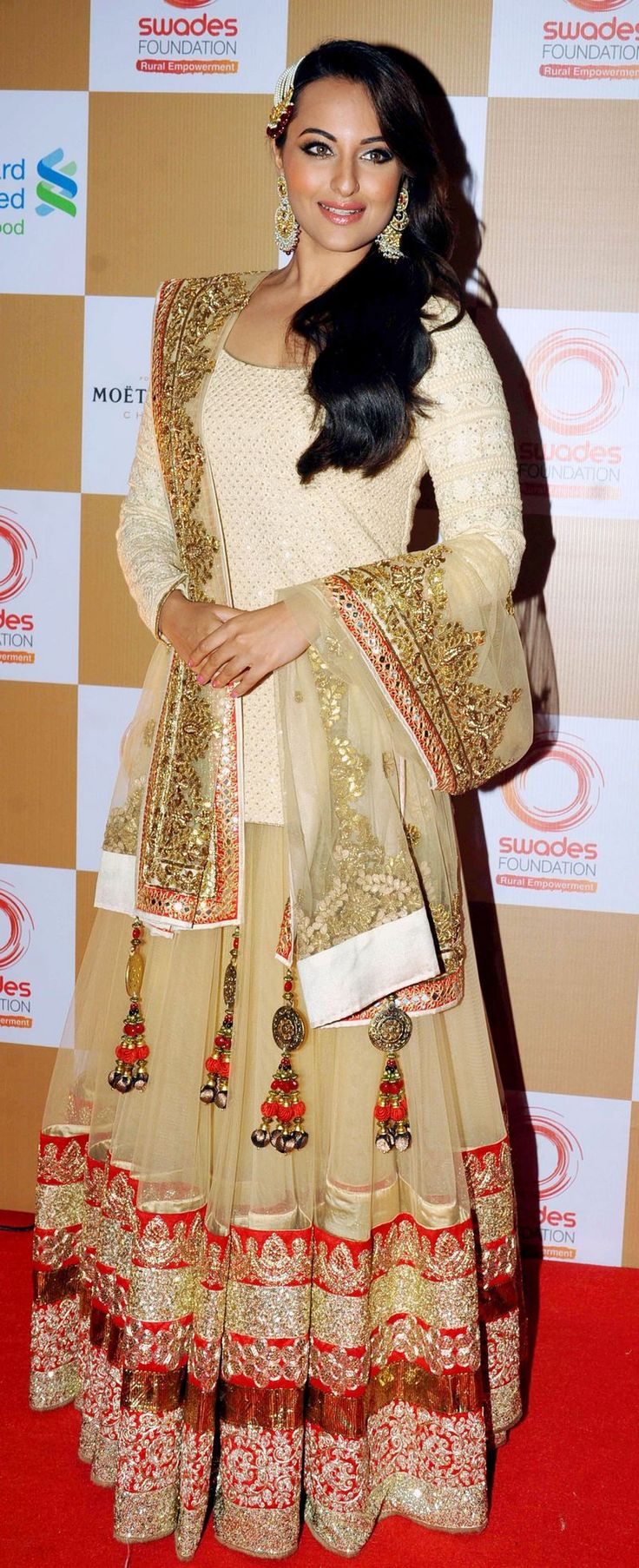 Sonakshi Sinha wore an ornate ghagra with a longer-than-usual choli at a fund raising event hosted by Swades Foundation.