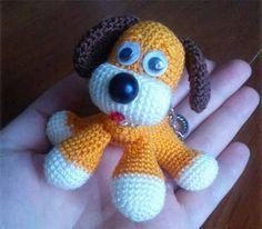 Вот такого забавного щенка можно связать крючком. Еще для него понадобятся пластиковые глазки и носик, наполнитель (например, синтепон). Голова: Оранжевым цветом: 1. 6 СБН в кольцо 2. 1Пр х6 (12) 3. …