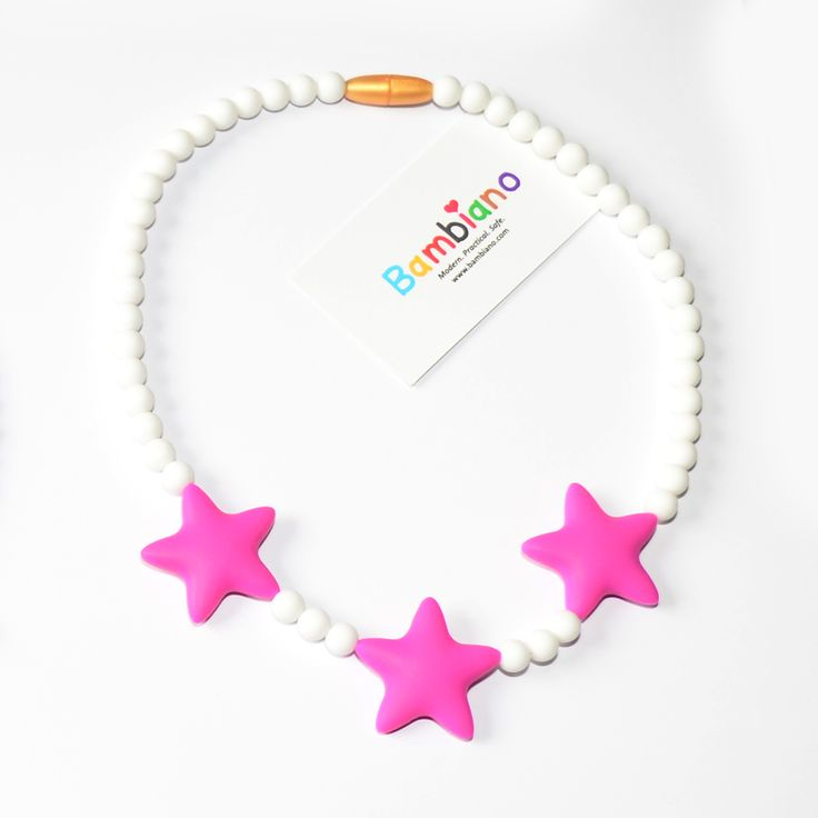 Bambiano Tona Star Necklace in Hot Pink. Bambiano Jr Necklaces are made of 100% Food grade silicone. BPA free, Lead free and nontoxic. Fashionable for trendy girls 3 years and above. Necklaces are colourful, washable and soft against the skin. Shop at www.bambiano.com