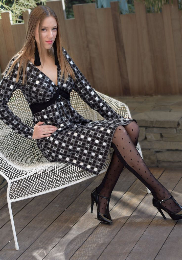Gray melange jersey dress with silver and black Polka-dot print. Knot-draped bodice to emphasize the bust. More dresses in Stylati Boutique.