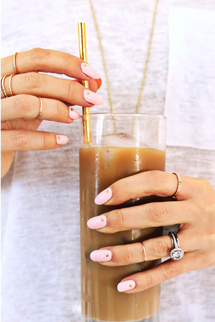 Need a quick & cute manicure idea for the holidays? Try this Gold Studded Mani DIY! Just pick your base coat, add a single gold nail stud to each nail, & you're golden!