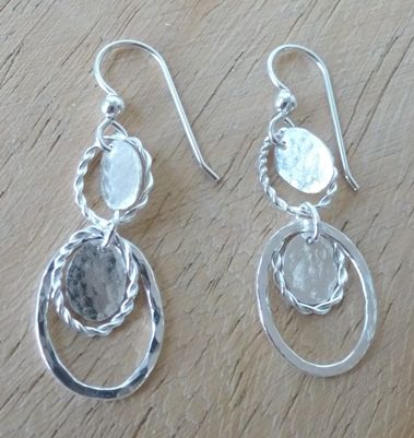 mini oval earrings with battered and twisted wire hoops and battered discs