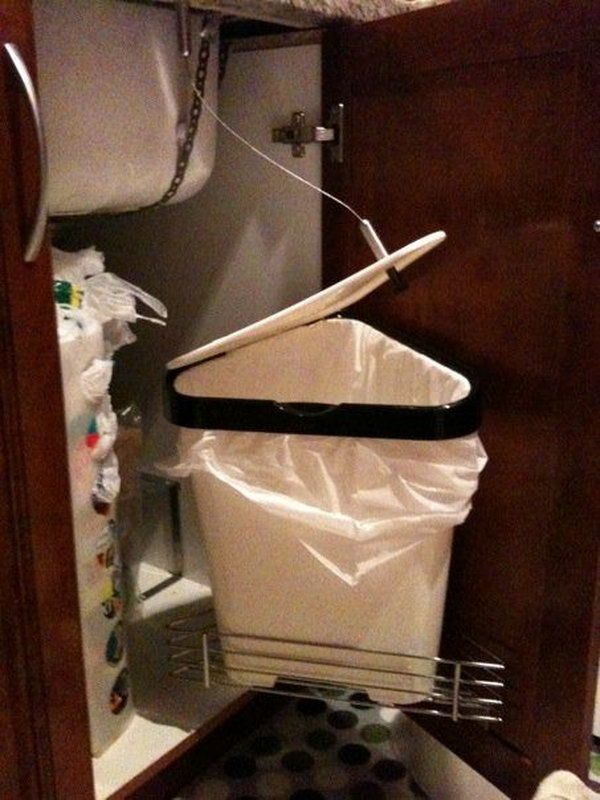 DIY Auto Opening Garbage Can. Make a sliding and auto opening garbage under the sink. The lid is connected to sink, so when door opens lid opens. http://hative.com/creative-under-sink-storage-ideas/