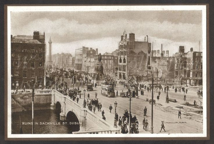 From a photo booklet published by Eason & Son of Dublin and Belfast regarding the Easter Rising of 1916.  From the bottom of the photo -  # Carlisle Bridge now O'Connell Bridge spans the River Liffey. It was opened in the early 1800's and is 164 feet wide by 147 feet long – that is, it's wider than it's long.  # Daniel O'Connell monument was designed and sculpted by John Henry Foley and completed by his assistant Thomas Brock. The foundation stone was laid in 1864 and the monument unveiled…