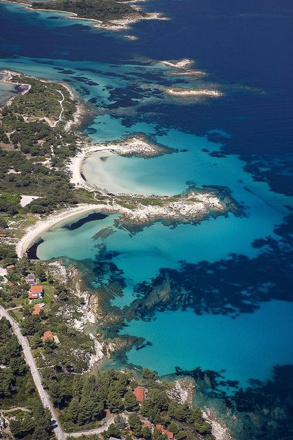 Vourvourou and Karidi beach In #Halkidiki. Shaped like Poseidon's trident and sticking out into the Aegean Sea, Halkidiki is a treat for visitors. Lush green forests that reach right down to the beach; golden sunlight reflected in the turquoise waters. #Greece #kitsakis