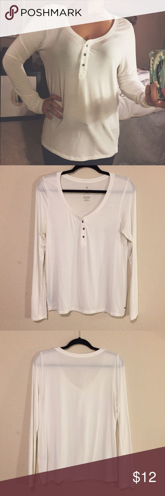 American Eagle soft and sexy Henley AE Outfitters soft and sexy long sleeve white Henley. Worn once or twice, super comfy and perfect with jeans or leggings. Tiny stain near hem, barely noticeable. Price reflects condition American Eagle Outfitters Tops Tees - Long Sleeve
