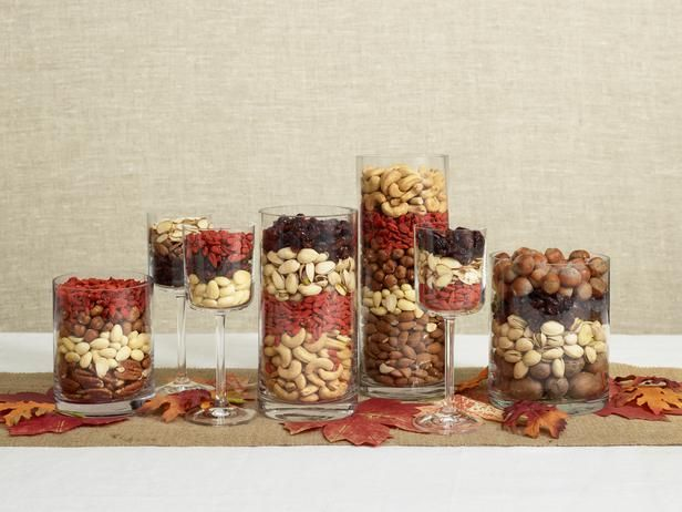 Trifled Nuts  Make an elegant centerpiece out of nuts and dried fruit by tiering them like a trifle dessert. Pair with gathered fall leaves for a naturally sophisticated centerpiece that is also edible.