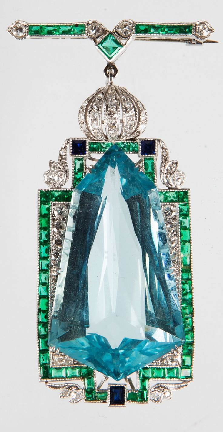 An Art Deco platinum, aquamarine, diamond, emerald and sapphire brooch/pendant. #ArtDeco #brooch #pendant
