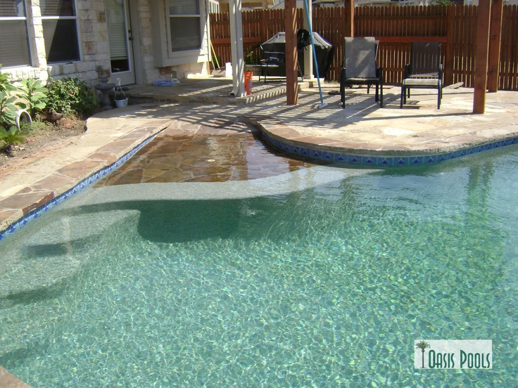 Steps off the side of beach entry or tanning ledge for Pool design with tanning ledge