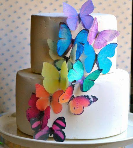 Rainbow wedding cake with buterfly