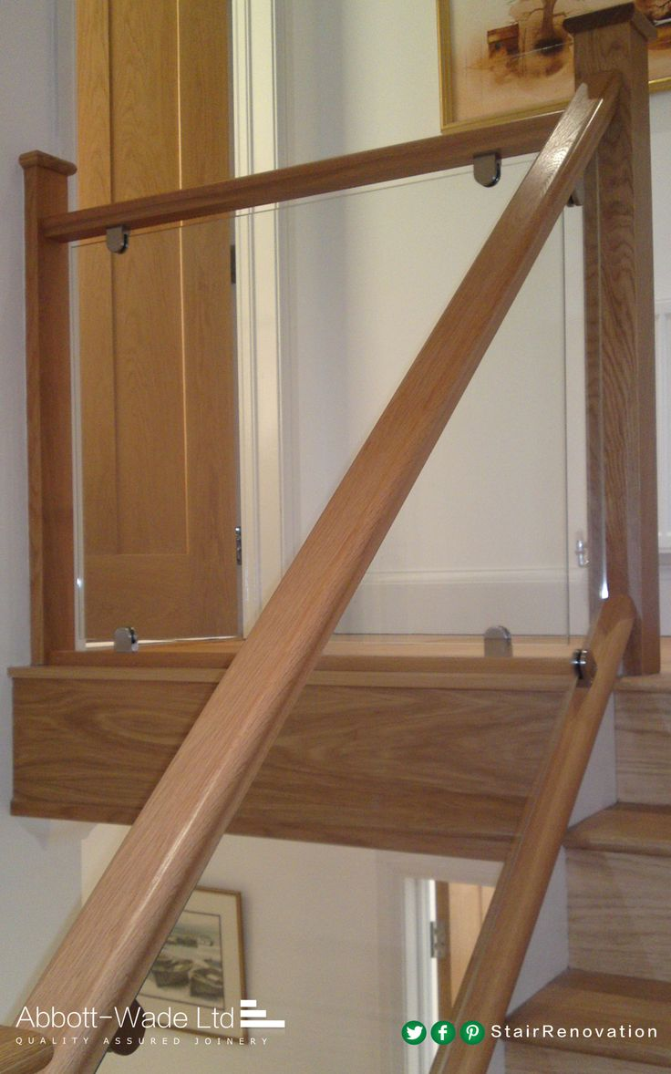 An elegant and contemporary oak and glass staircase installation.