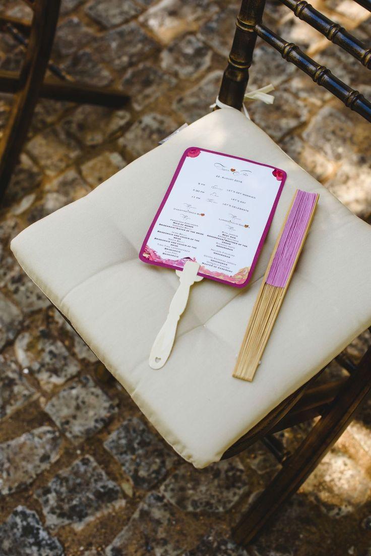 Pink DIY hand painted wedding program & fan. Cake & Confetti Weddings. Photo by Quemcasaquerfotos