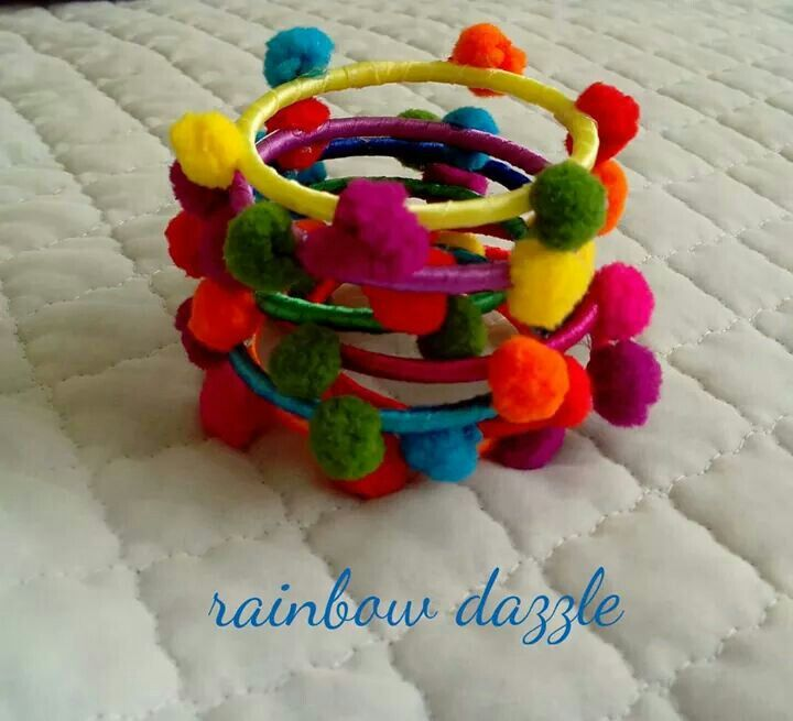 Handmade pom pom bangles in flashy funky colours