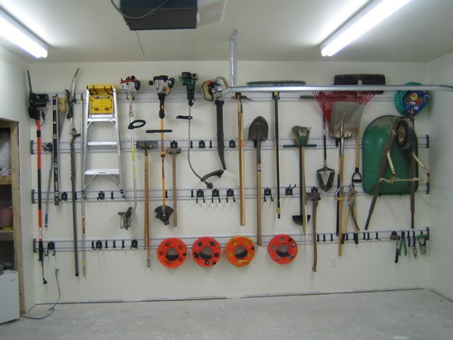 Rails keep storage space to a minimum  leaving more parking space  Great  for one. 8 best Garage interiors images on Pinterest   Garage interior