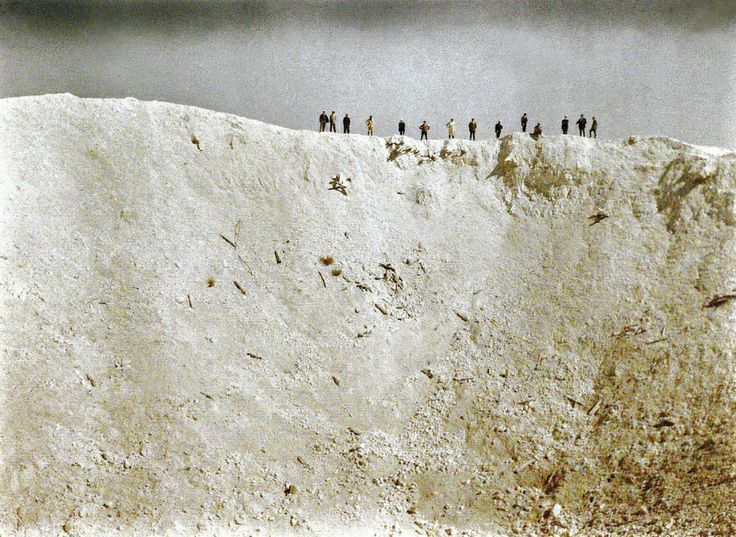 """""""A crater caused by the explosion of 19 mines placed underneath German positions near Messines in West Flanders by the British on June 7, 1917. A total of about 10,000 soldiers died, amongst them almost all of the 3rd Royal Bavarian Division. The blast was one of the biggest non-nuclear explosions of all times and was audible in Dublin and London."""" R. Schultz Collection / The Image Works. Rare Color Photographs from the Trenches of World War I."""