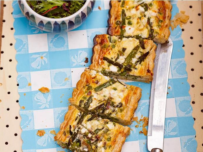 This savoury tart is packed with zucchini, peas and antioxidant-rich asparagus. I use puff pastry sheets layered with parmesan to make the crust but you can mix and match with other savoury pastry options such as layers of filo or a herby shortcrust.