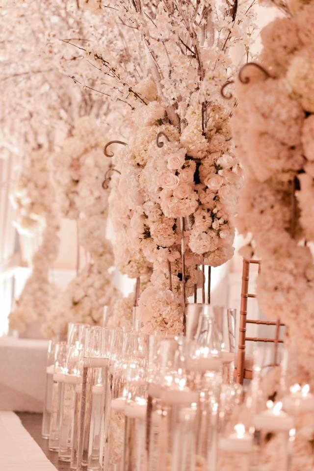 Decadent Blush and white florals and lighting for reception