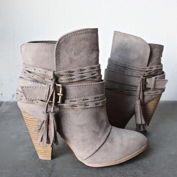 """A striking suede bootie with a stacked block heel. This bootie is as versatile as it is elegant. How it fits: - Shaft: 5.5"""" - Opening: 10"""" - Heel: 3.75"""" - Platform: 0.25"""" Fabric & care: All man made m"""