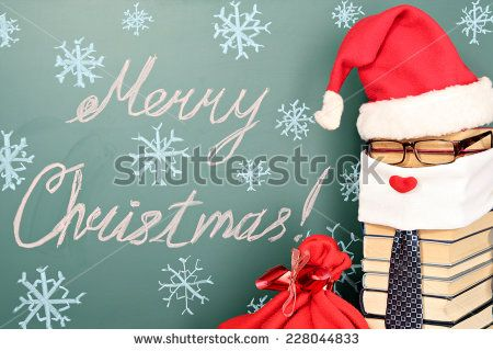 Unusual Santa Claus from books with bag of gifts before blackboard with title MERRY CHRISTMAS!