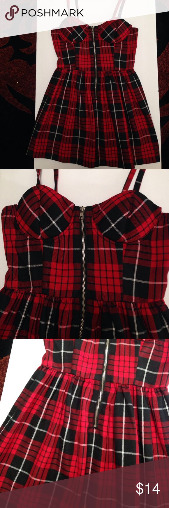 Plaid schoolgirl zip front bustier dress Plaid schoolgirl bustier dress with silver zip front, a line full skirt, and stretch panel in back. This one is super short so if you're tall it's probably a top or you'll need to wear leggings. Or be very popular lol. From top of zipper to bottom hem is 22 inches. New with tag. Size junior M. Poly blend. Dresses Mini