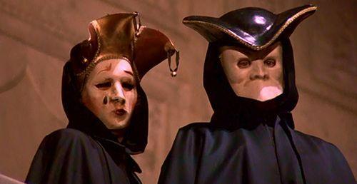 "A couple wearing Venetian masks (""female jester"" and ""bauta""), costume design by Marit Allen, for Eyes Wide Shut (1999)."