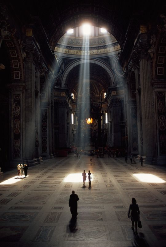 Three shafts of sunlight illuminate the basilica and its mosaic floor in the Vatican, December 1971. Photograph by Albert Moldvay, National Geographi