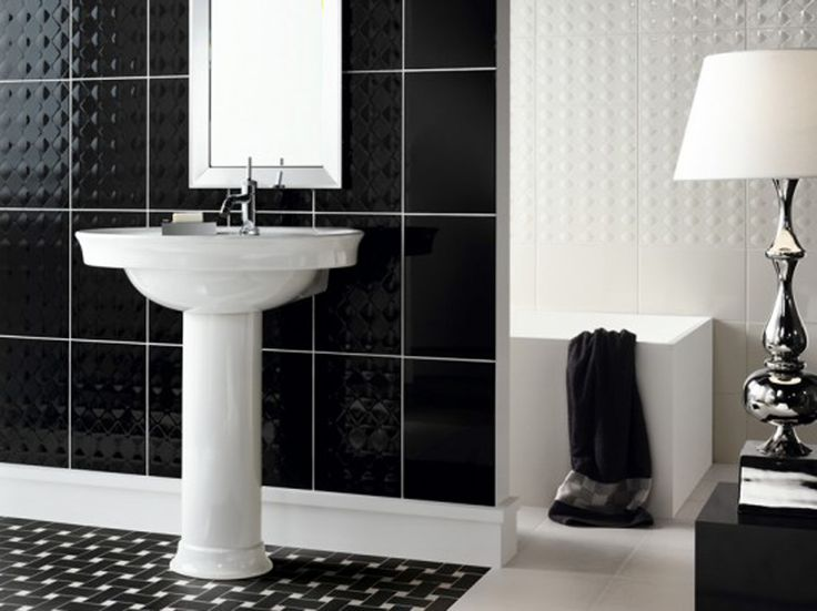 modern bathroom using black and white mosaic tiles as flooring and large black tiles as backsplash
