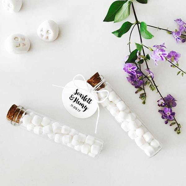 These mint-filled glass tubes with cork lids and personalised tags are wedding favours with style. Delivery across Australia.