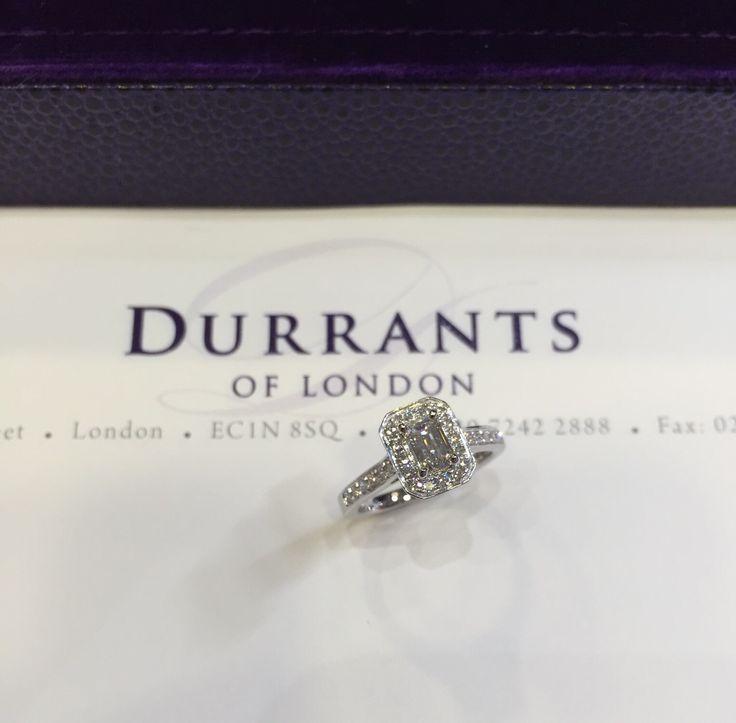 Emerald cut halo ring made in platinum