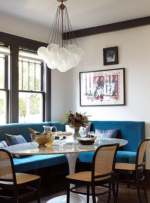 roomy breakfast nook with that gorgeous blue and chandelier!