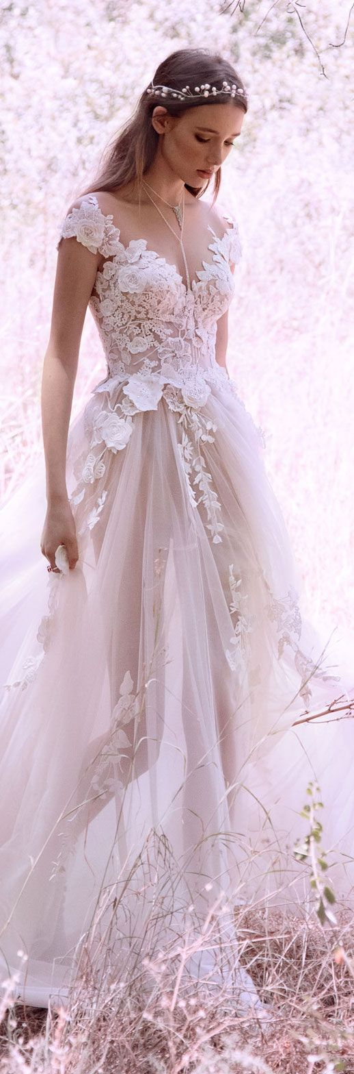 GALA 902. Impressive ball gown dress with a rosé sheer tulle skirt with handmade flower appliques and off the shoulder sleeves.