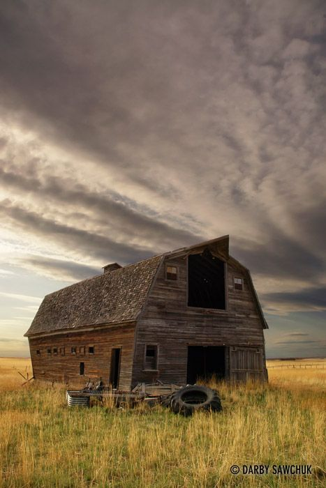 Clouds gather over a dilapidated barn in the Southern Alberta prairies. Photo by Darby Sawchuk