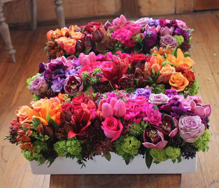 Rainbow trough centrepieces - Rustic wedding flowers made by Amy's Flowers