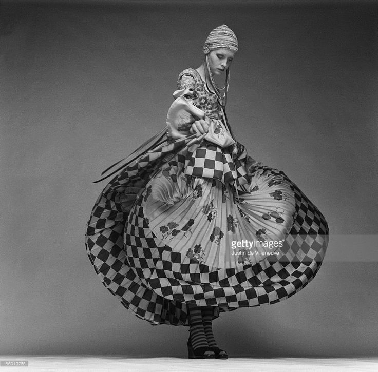 British model Twiggy wearing a peasant-style dress by Bill Gibb with a full skirt and a knitted cap, circa 1970. The dress was specially designed for her to wear to the premiere of Ken Russell's 'The Boy Friend'.