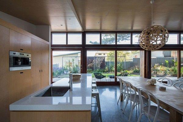 Sleek modern kitchen with island countertop in white