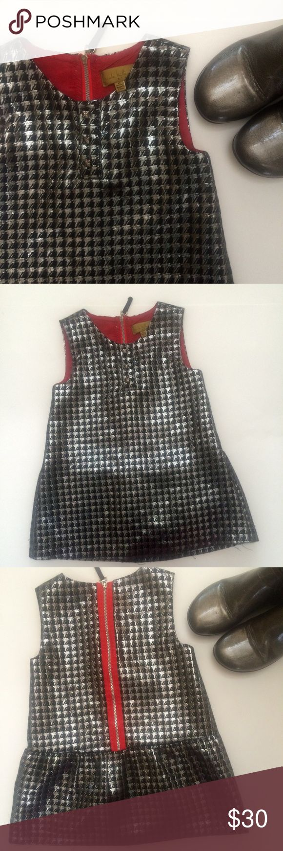Nicole Miller Kids Metallic Special Occasion Dress Simply adorable metallic holiday dress by Nicole Miller Kids. Beautiful black and silver thread houndstooth pattern. A-line design, 3 metal buttons adorn the front, lined, red detail on back, shiny silver zipper with black velvet pull, sleeveless. VGUC. Nicole Miller Dresses