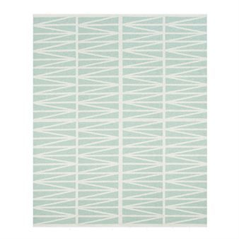 Helmi large rug in beautiful Light turquoise and white colors comes from the Swedish company Brita Sweden. It is also available in Ocra orange and Amethyst grey.