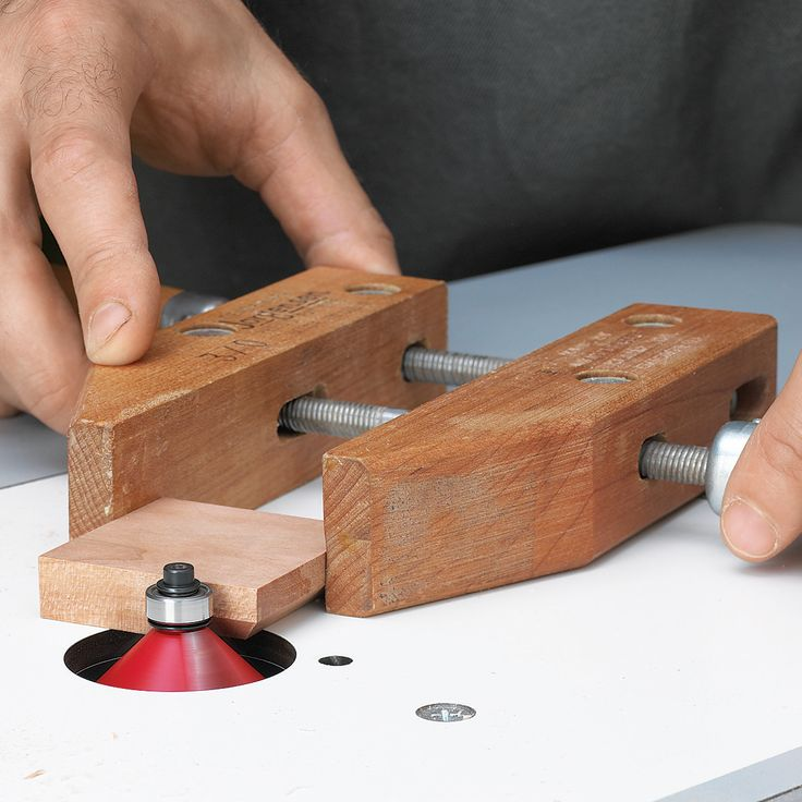 """A wooden handscrew clamp serves as a safe """"extension"""" of your hands, gripping the small part firmly while sitting flat on the table surface as you rout its edges."""