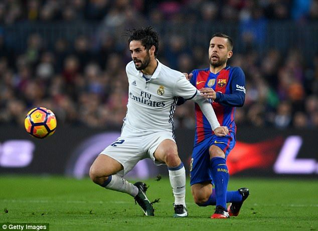 Barcelona defender Jordi Alba challenges Isco for the ball during El Clasico in December