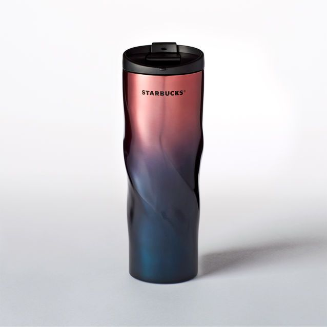 A stainless steel tumbler with a unique ripple shape and a gradient finish. Part…