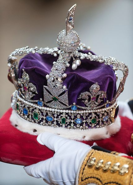 Queen Elizabeth II's crown is prepared before the State Opening of Parliament in the House of Lords at the Palace of Westminster on May 18, 2016 in London, England.
