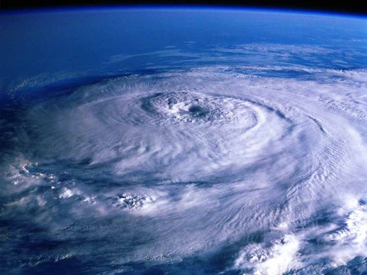 Cyclone over Earth - view from Space. Space Views Free Computer Desktop Wallpaper