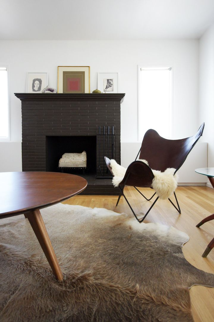Love the rug...and the fire place! That is all..I don't like the chair