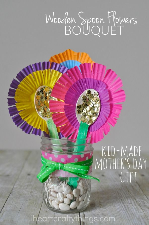 This pretty Mother's Day flower bouquet gift is simple to create and makes a bright and pretty decoration for Mom or Grandma to display in their home. The colorful flowers are made from wooden spoons and cupcake liners.